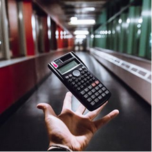 students hand extended infront of the camera with calculator floating above it