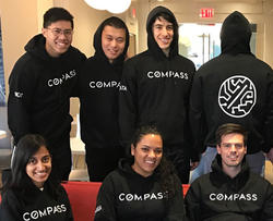 Compass employees in matching sweaters