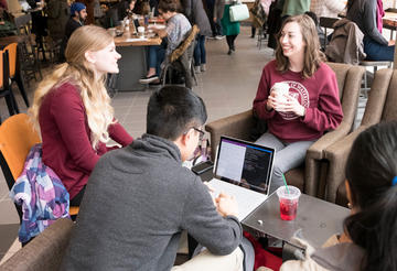 Students sitting around table in Starbucks