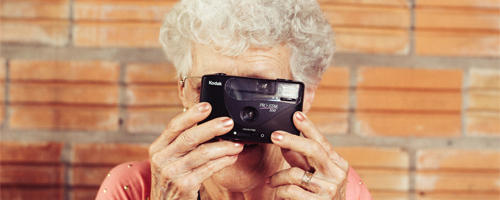 Older lady with a camera.