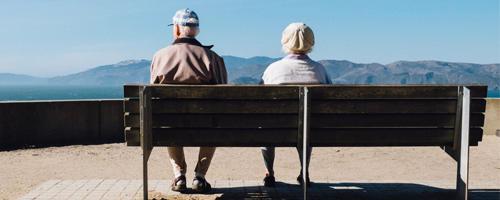 Seniors sitting on a bench.