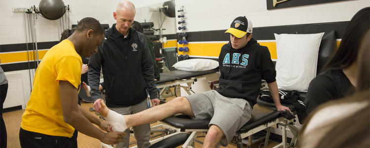 Learning to wrap an injured ankle.
