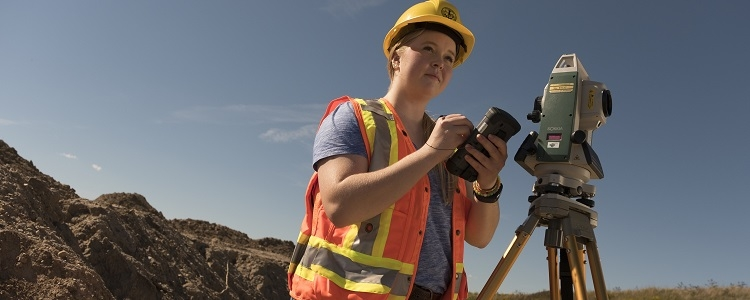 Geological engineering student using surveying equipment