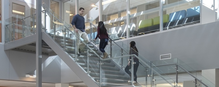 Students walking up stairs in Mathematics building