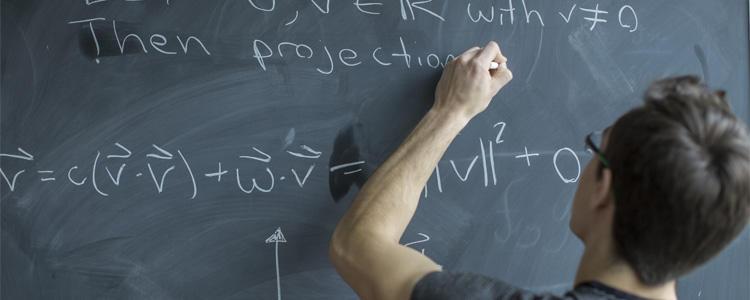 Writing on a chalkboard.