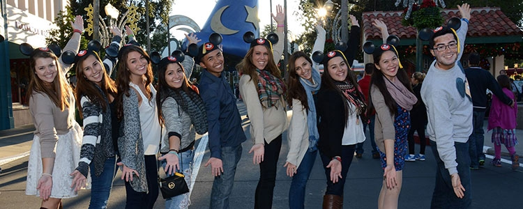 Students in the recreation and leisure studies degree program wearing mouse ears at Disney