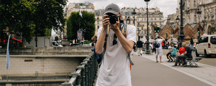 Taking a photo on a street in France.