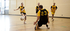 Students playing indoor soccer