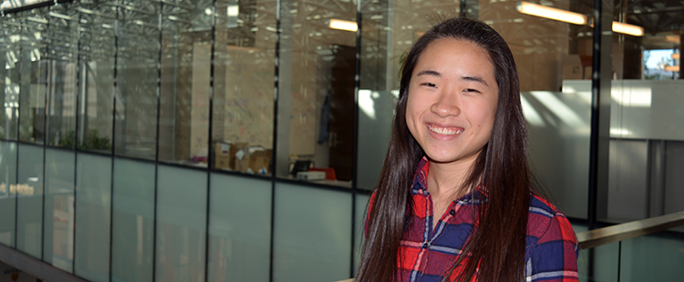 female student smiling at camera