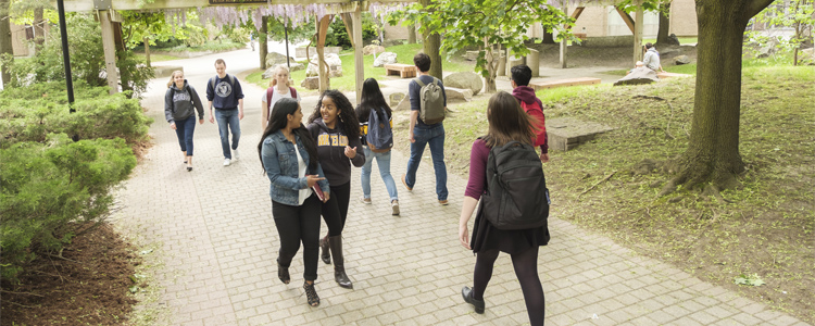 Waterloo students walking on campus.