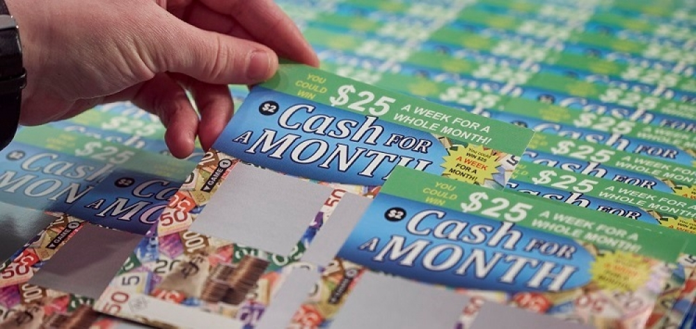 Photo of cash for month card being chosen