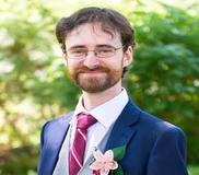 Nicholas in suit smiling