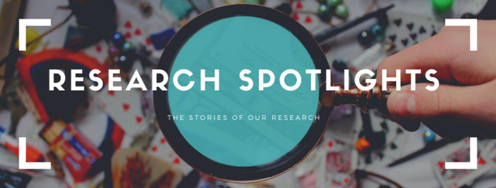 Research spotlights banner with magnifying glass over cards