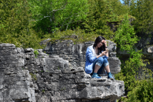 Jewel sitting on cliff