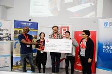 Kenny and team holding cheque