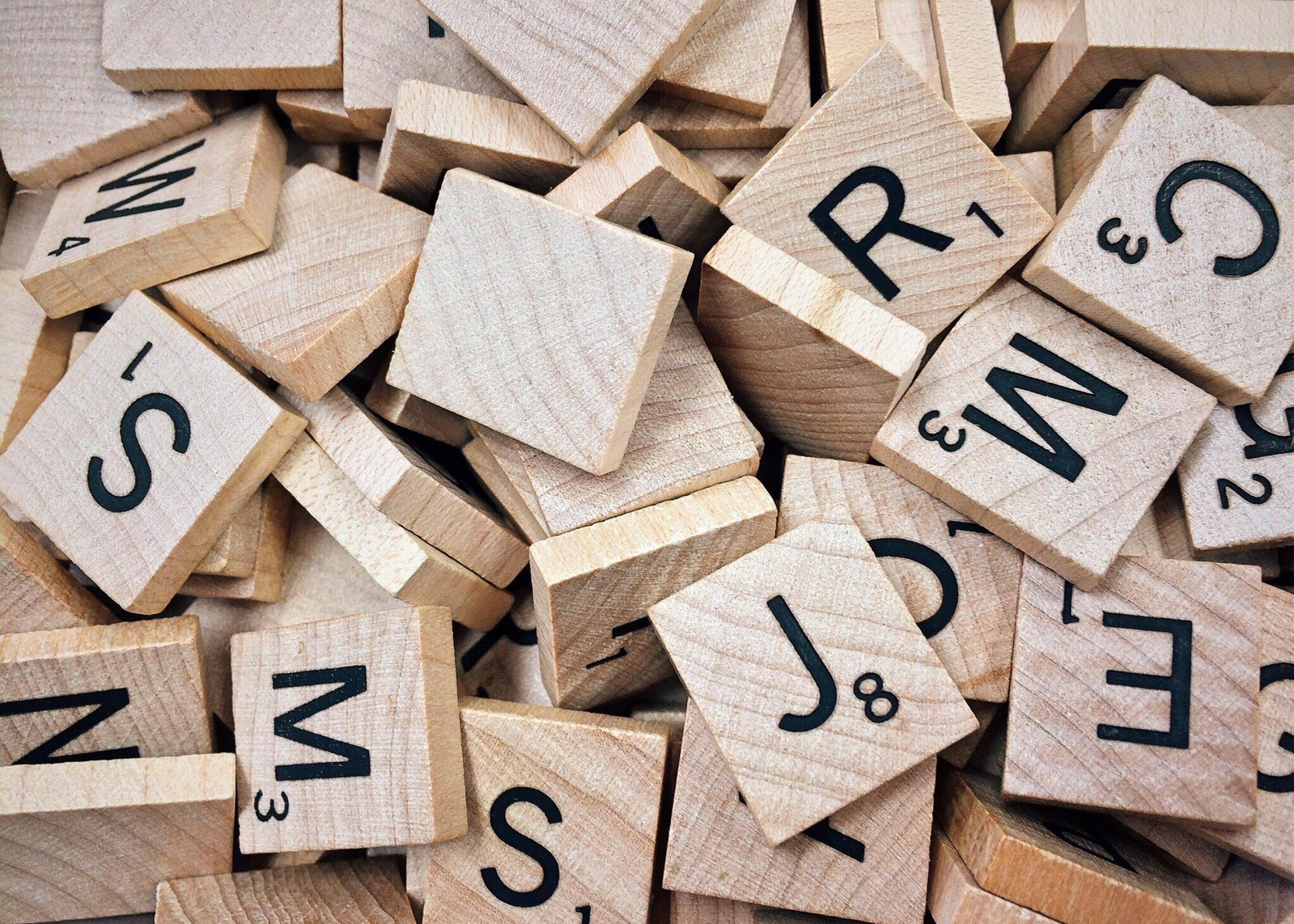 Scrabble tiles in a pile
