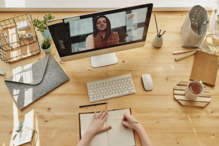 Working online video with a person on a screen (from Canva stock images)