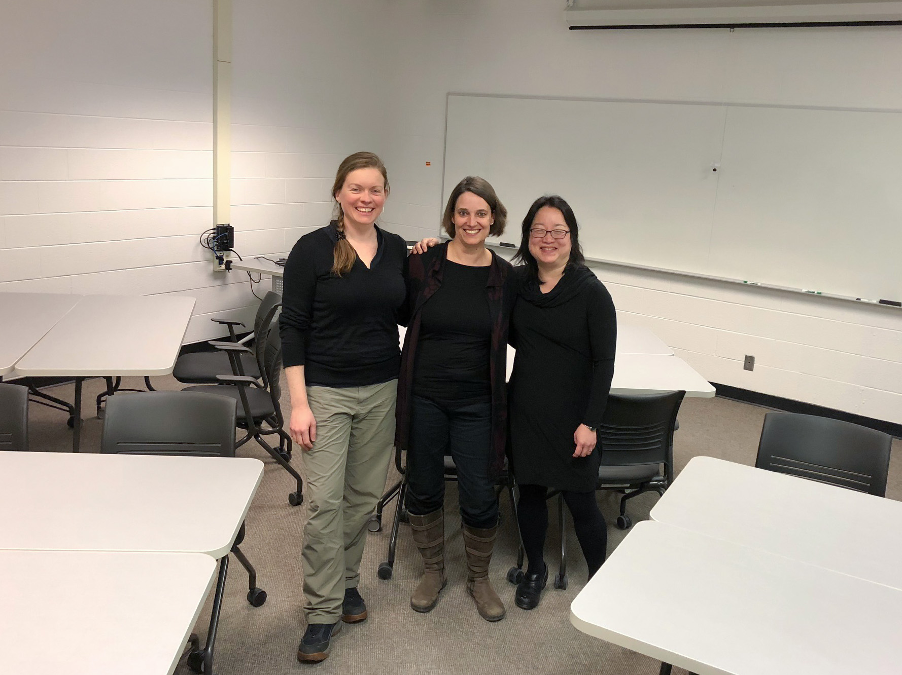 Emma Betz, Grit Liebscher and Adrienne Lo standing in a classroom