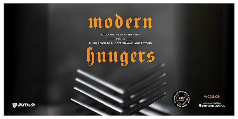 Symbolic picture of two forks forming a fence with modern hungers written above them