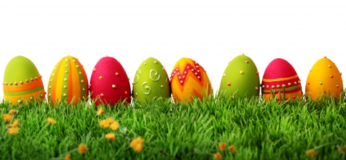 Painted Easter eggs atop green grass