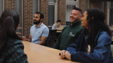 students talking at a table