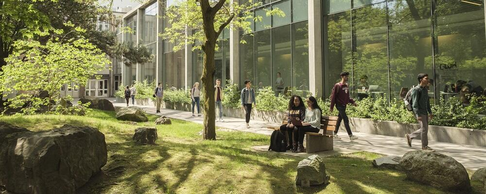Students sitting on a bench in the Peter Russel Rock Garden