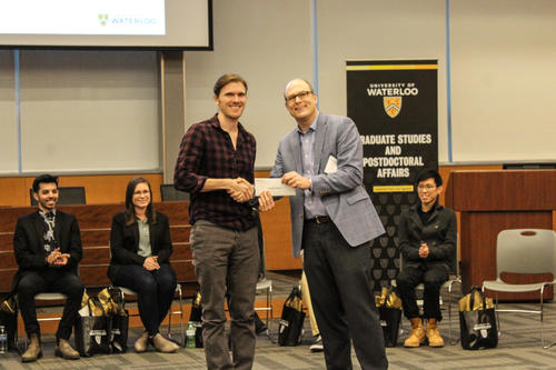 Jason Lajoie accepts his 2nd place GRADflix prize from Jeff Casello
