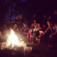 Lake Shifters sitting around a fire at night