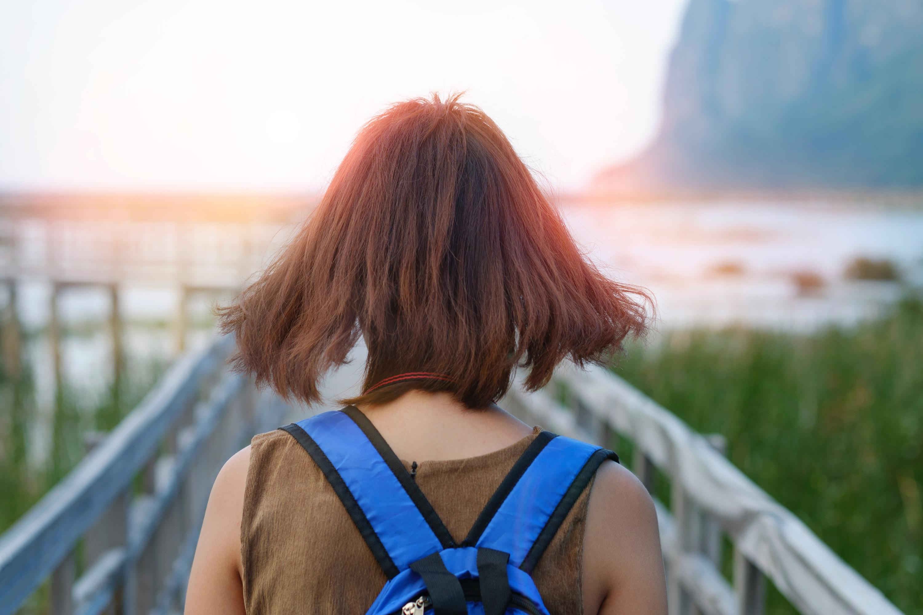women carrying backpack in warm sunny location