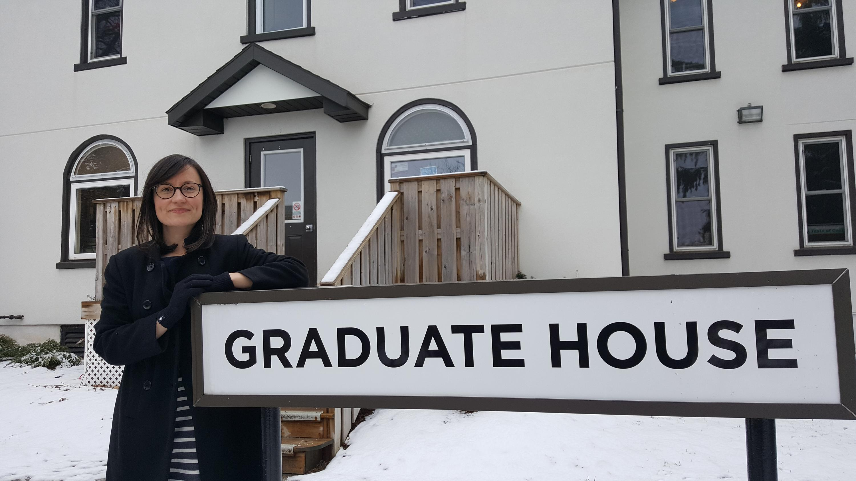 Beth with the graduate house sign