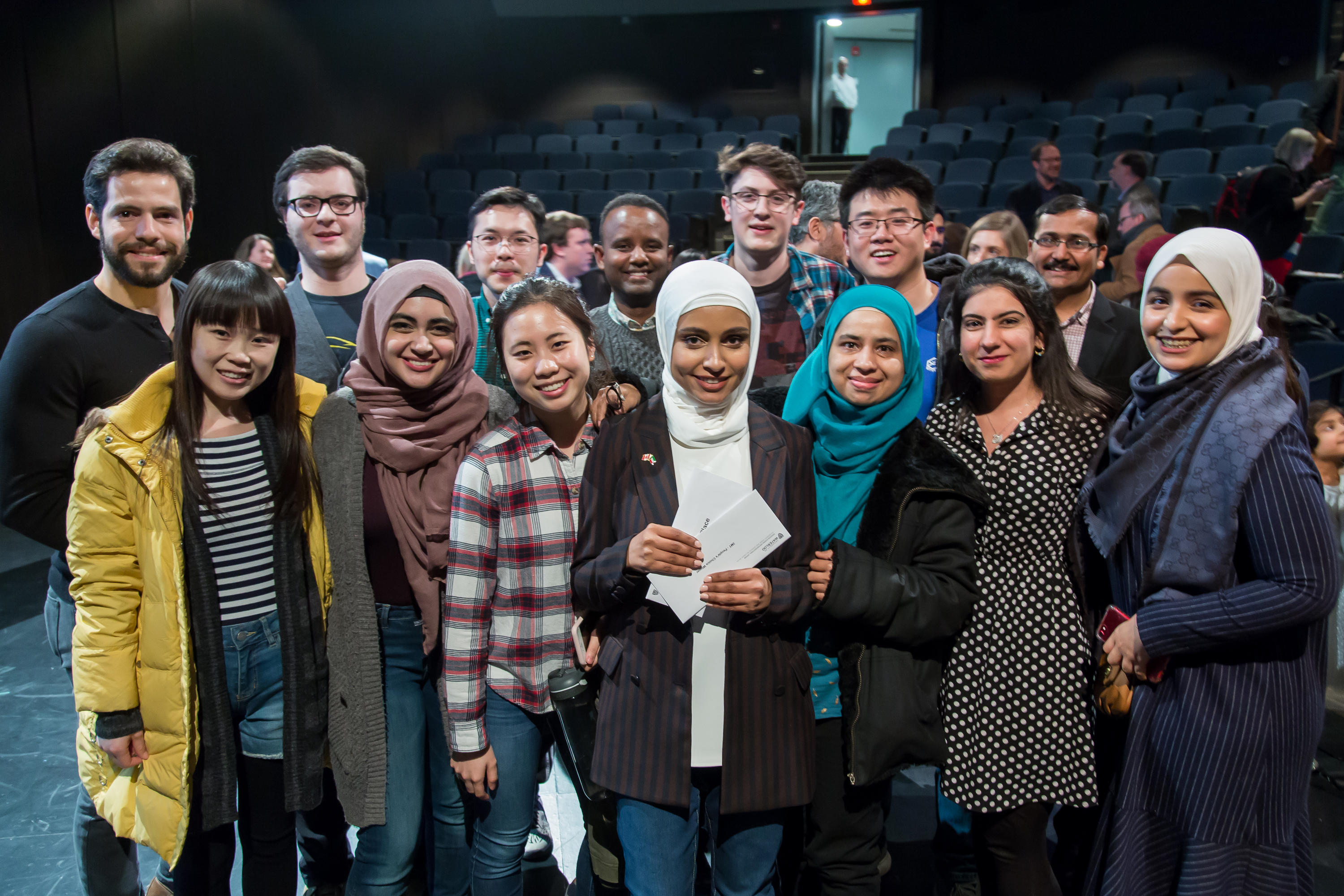 Group of students supporting UWaterloo 3MT winner, Haya.