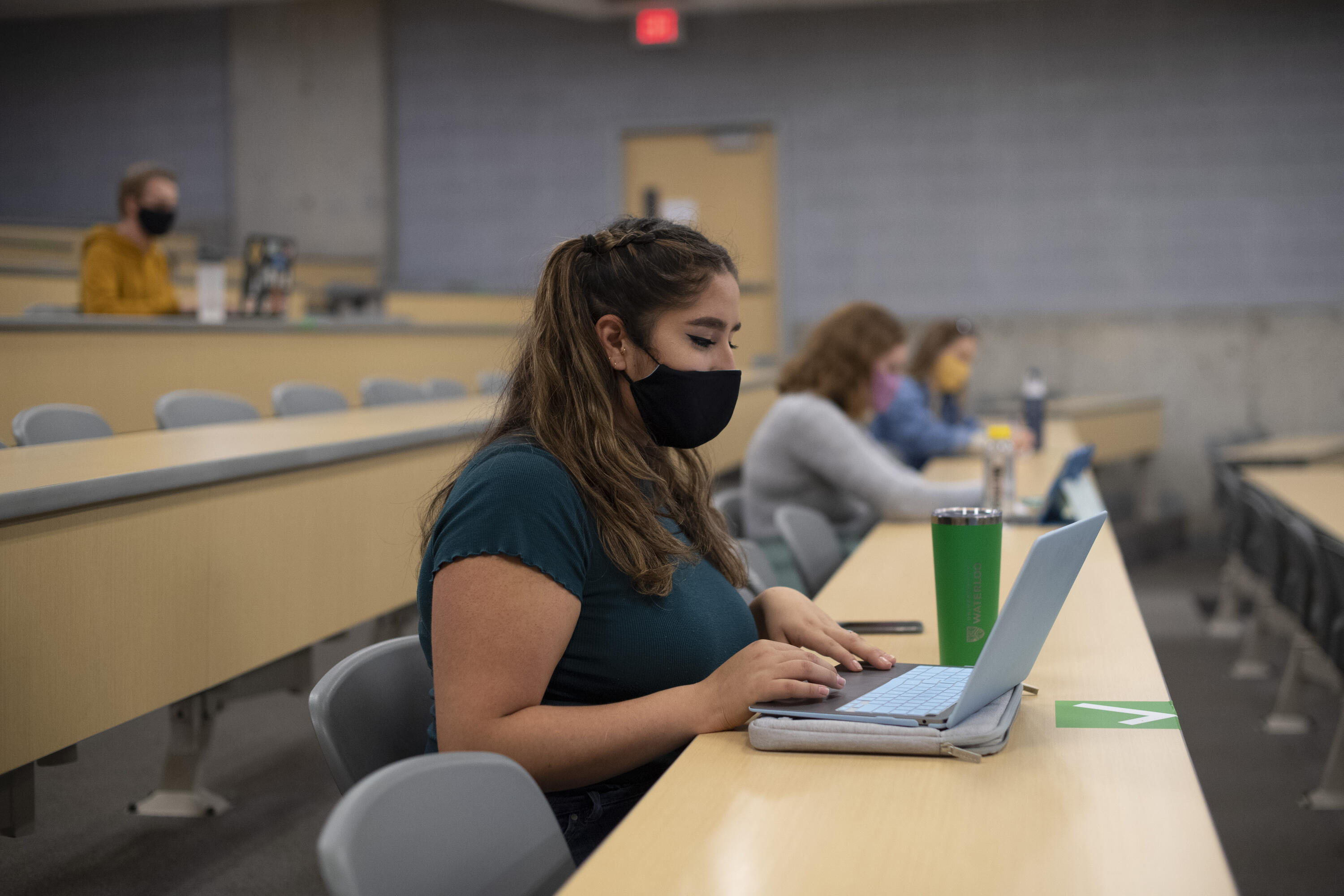 Masked student in classroom