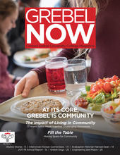 Grebel Now Fall 2018 cover: student holding tray of food in dining area