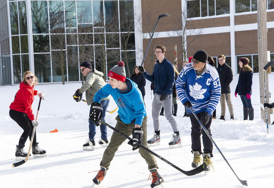 staff and faculty vs students hockey game on student-built rink