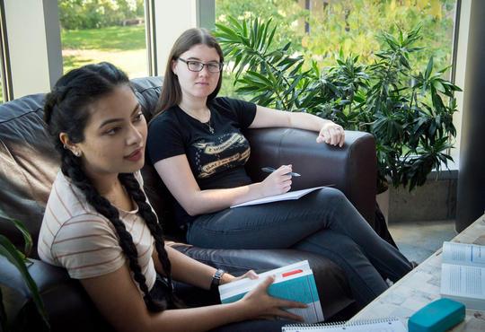women talking together at Grebel