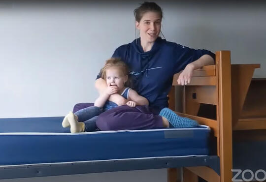 Faith and Ronen sit on an empty bed in the empty Grebel residence building