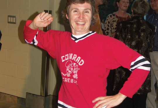 Melodie shows off her Grebel Hockey Jersey from the 1980s, when she returned for an alumni reunion in 2006.