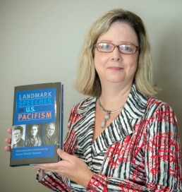 Susan Huxman holding her new book