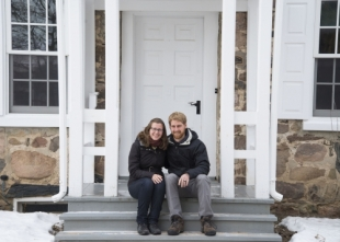 Laura and Joshua Enns in front of the Brubacher house