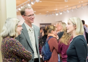 Susan Schultz Human and Paul Heidebrecht visit with Shannon Moroney in the Grebel Gallery
