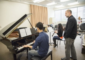 Students Playing music at Ensemble Rehearsal Studio