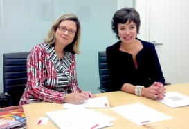 Susan Schultz Huxman and Women's Executive Network  Founder Pamela Jeffery sign papers for the new MPACS award.