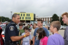 Campers talk to a police officer.
