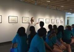 Campers listening to Michelle Jackett speak in the Grebel Gallery