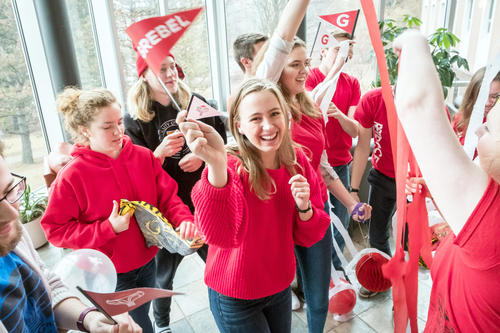 Grebel Students all waring red. Dancing and having fun while showing Grebel pride!