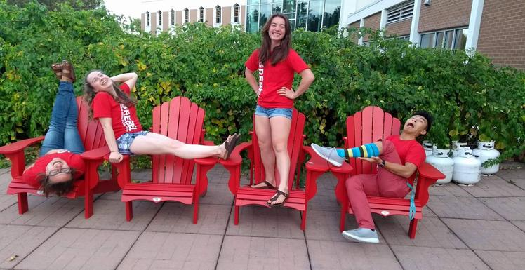 Grebel Students sitting on Muskoka chairs