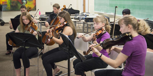 Ontario Mennonite Music Camp kids playing violin