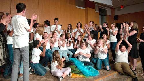 students cheer on stage
