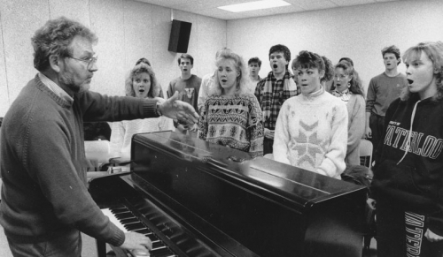 Bill Maust conducts a choir at Conrad Grebel University College