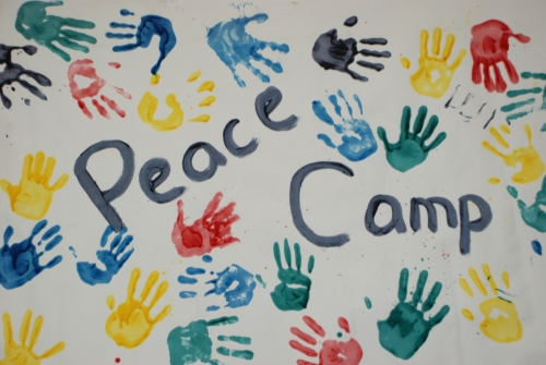 Peace Camp Sing painted using camper handprints